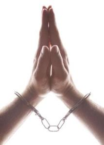praying-hands-in-cuffs-vert
